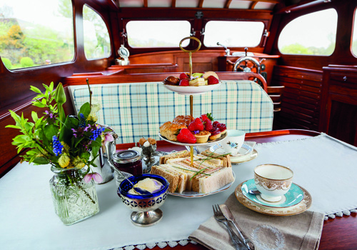 Vintage Days Out-food-afternoon-tea-inside-boat-500x350